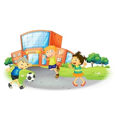 Children playing football at the school vector image vector image