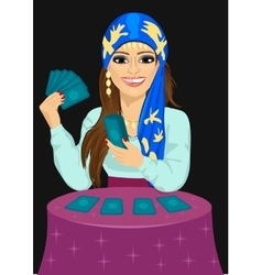 Young fortune teller with tarot cards vector