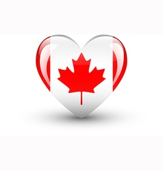 Heart-shaped icon with national flag canada vector