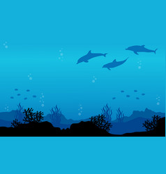 Silhouette of dolphin on underwater landscape vector