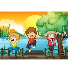 Three happy boys at the wooden bridge vector image
