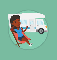 woman sitting in chair in front of camper van vector image