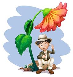 A boy sitting at the rock below a big flower vector