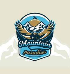Logo emblem of an eagle flying mountains rocks vector