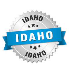 Idaho round silver badge with blue ribbon vector