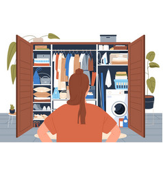 Woman standing in front of tidy wardrobe after vector