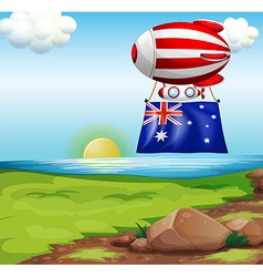 A floating balloon with the flag of australia vector