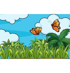 Butterflies flying in the garden vector