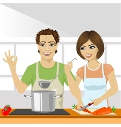 young couple cooking soup together in kitchen vector image