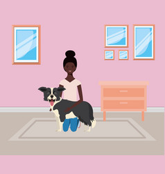 Young afro woman lifting cute dog indoor house vector