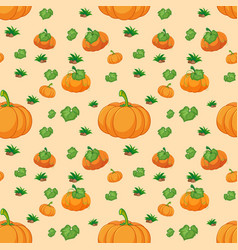 seamless pattern with pumpkins on orange vector image