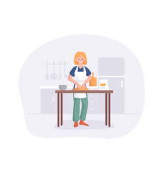 Young woman knead dough on table in kitchen vector
