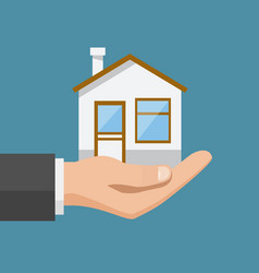Real estate offer businessman holding a house vector