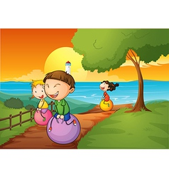 Happy kids playing with the bouncing balls vector image vector image