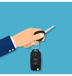 Hand holding car key or home key vector image