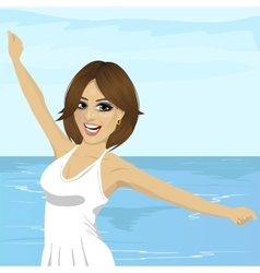 Woman with her hands raised at beach vector