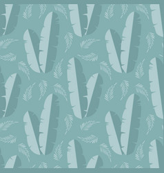 Seamless pattern with jungle palm leaves on blue vector