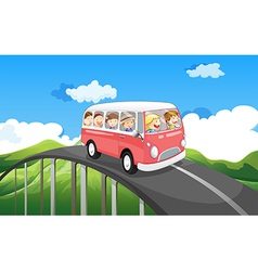 A school bus with kids travelling vector image