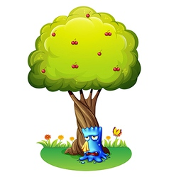 A blue monster sobbing under tree vector