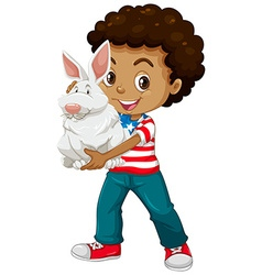 American boy holding a white rabbit vector image vector image