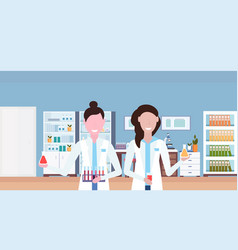 couple female scientists working in hospital vector image