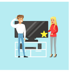Young blond woman choosing tv with shop assistant vector