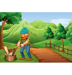 A lumberjack chopping the woods at the pathway vector image