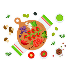 Vegetables and herbs on a cutting board top view vector