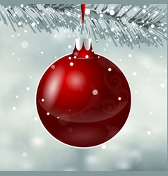 red christmas toy on snowfall background vector image
