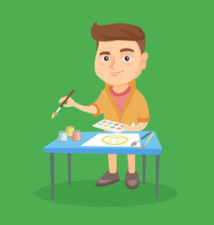 caucasian boy drawing a picture with a paint brush vector image