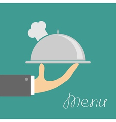 Hand with silver platter cloche and chefs hat Menu vector image