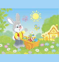 bunny with a handcart of painted easter eggs vector image