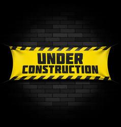 under construction banner on black vector image