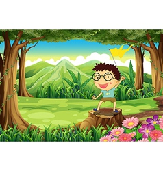 A boy above the stump holding a yellow banner vector image