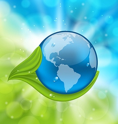 Planet earth with green leaves vector