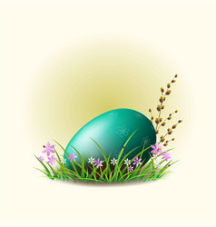 easter egg with a willow branch on a green grass vector image