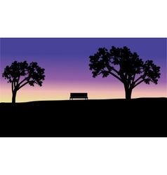 Silhouette of bench in fields vector image