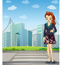A tall woman standing near the pedestrian lane vector