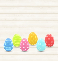 Wooden background with colorful traditional eggs vector