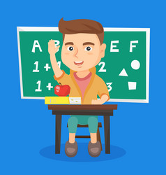 schoolboy raising hand while sitting at the desk vector image