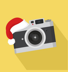 Flat vintage camera with hat christmas vector
