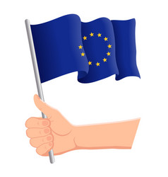 hand holding and waving national flag of vector image