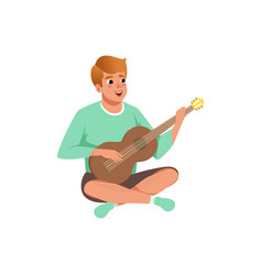 Man sitting with crossed legs playing the acoustic vector