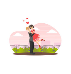 young man holding beloved girl in his arms happy vector image