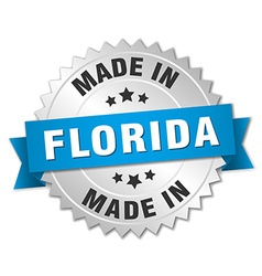 Made in Florida silver badge with blue ribbon vector