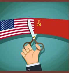 Human hand with scissors cuts the usa flag vector