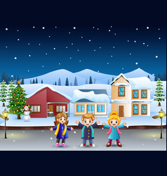 Happy kids playing in front of the snowing village vector