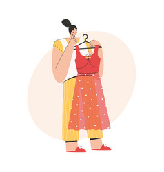 woman thinking and holding fashionable dress vector image