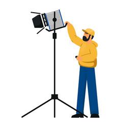 Lighting technician with spotlight equipment vector