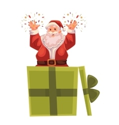 Full length portrait of Santa popping out a box vector image